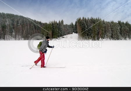 Novice Cross Country Skier stock photo, A cross country skier out on a refreshing trip over a frozen lake. by Tyler Olson