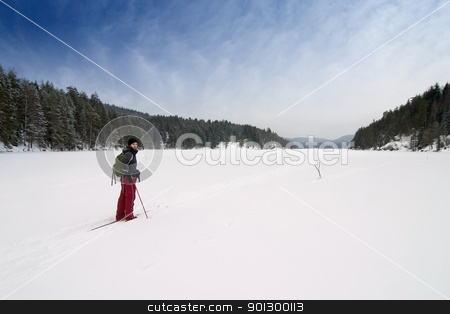 Cross Country Skiing stock photo, A cross country skiier out on a refreshing trip over a frozen lake. by Tyler Olson
