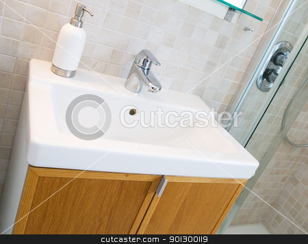 Bathroom Sink stock photo, A standard new bathroom sink with tiles on the wall. by Tyler Olson