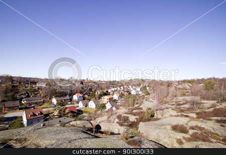 Houses in Rock Valley stock photo, A street following a valley in a rock countryside.  Fredrikstad Norway. by Tyler Olson