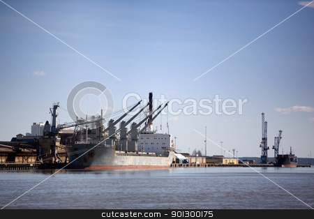 Cargo Ship stock photo, A large cargo ship in the harbour by Tyler Olson