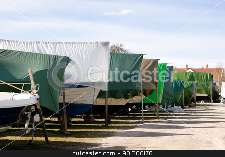 Winter Boat Storage stock photo, A row of boats in storage for the winter in Norway. by Tyler Olson
