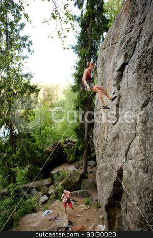 Two climbers stock photo, A female climber, repelling down a steep rock face (crag) by Tyler Olson