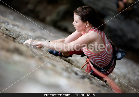 Female Climber stock photo, A female climber on a steep rock face.  Shallow depth of field is used to isolated the climber. by Tyler Olson