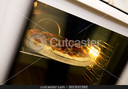 Pizza Baking in Oven stock photo, A homemade pizza baking in an oven by Tyler Olson