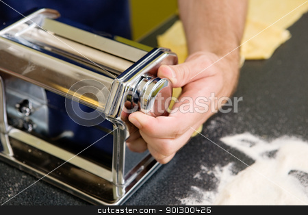 Pasta Machine stock photo, Adjusting the roller on a manual pasta machine by Tyler Olson