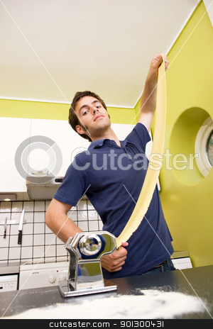 Proud Pasta Maker stock photo, A male proudly showing off his homemade pasta at home in the kitchen by Tyler Olson