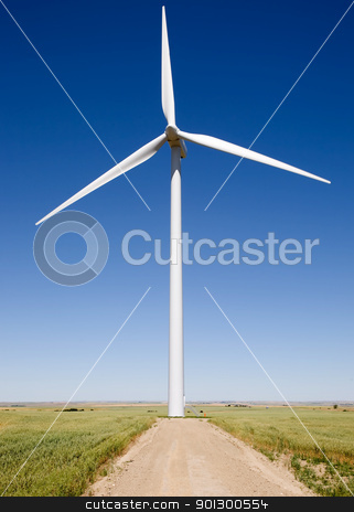 Renewable Resource stock photo, A close up of a wind turbine on the flat prairie by Tyler Olson