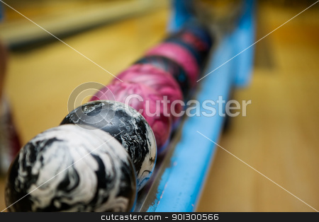 Bowling Ball Detail stock photo, A close up detail image of a set of 5 pin bowling balls.  Shallow depth of field is used with focus on the second ball. by Tyler Olson