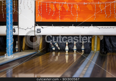 Retro Bowling Alley stock photo, A retro bowling alley detail with 2 pins being knocked down. by Tyler Olson