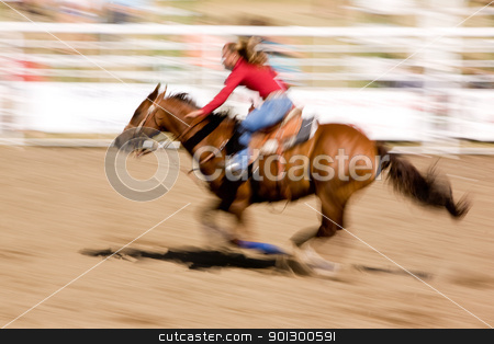 Speed Horse stock photo, A horse running fast with a female rider - with motion blur. by Tyler Olson