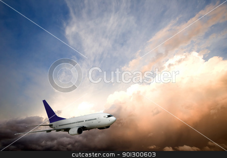 Airplane Sunset stock photo, An airliner flying into the sunset by Tyler Olson