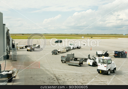 Baggage Cars stock photo, Baggage cars at an airport terminal. by Tyler Olson