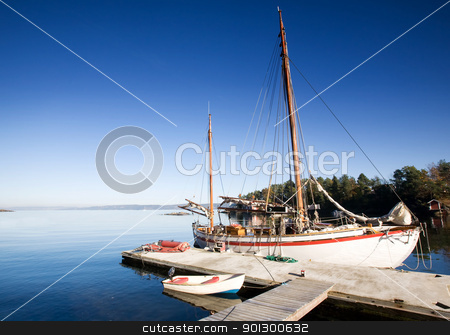 Sail Boat stock photo, A sail boat at on the ocean in dock by Tyler Olson