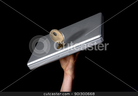 Laptop Security stock photo, A large key keeping a laptop locked by Tyler Olson