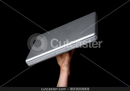 Laptop on Display stock photo, A handholding a small laptop computer with a blank screen. by Tyler Olson