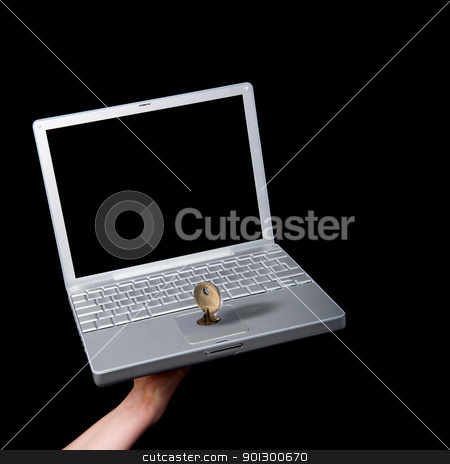Computer Security stock photo, A key locking the mouse pad on a laptop computer by Tyler Olson