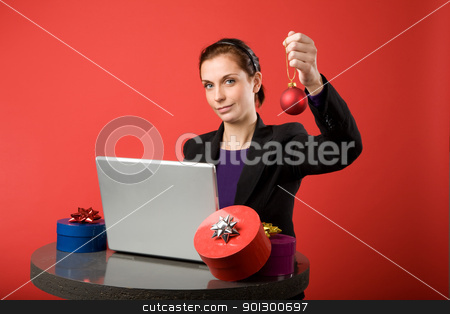 Christmas Online stock photo, A young female shopping for christmas presents online.  by Tyler Olson