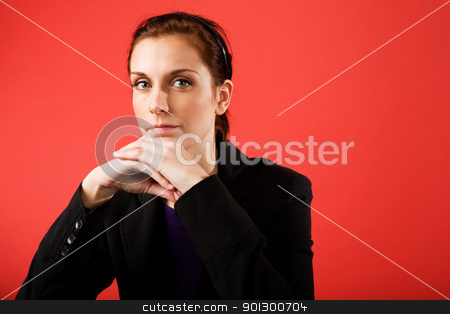 Confident Business Woman stock photo, A young content business woman looks at the camera by Tyler Olson