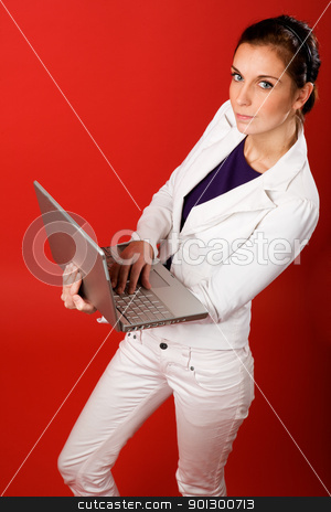 Mobil Business stock photo, A young business woman or student using a laptop by Tyler Olson