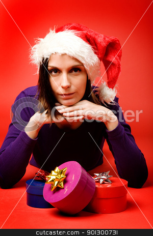 Present on Red stock photo, A young woman with a present isolated on red by Tyler Olson