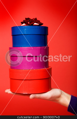 Gift Stack on Red stock photo, A stack of three gifts isolated on red with room for copy space by Tyler Olson