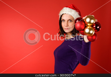 Christmas Decorations stock photo, A young female holding up christmas decorations by Tyler Olson