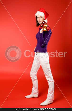 Female with Christmas Decorations stock photo, A young female holding up christmas decorations by Tyler Olson