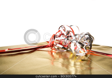 Isolated Gift with Bow stock photo, Golden present isolated against a white background by Tyler Olson