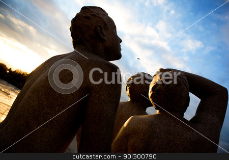 Future Vision stock photo, A statue of a group of boys looking into the sky by Tyler Olson