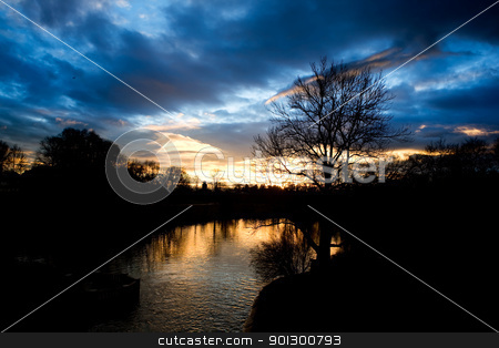 Lake Sunset stock photo, A dramatic sunset over a small lake by Tyler Olson