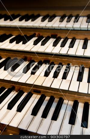 Pipe Organ Keyboard stock photo, An old pipe organ keyboard in a church by Tyler Olson