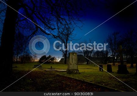 Graveyard stock photo, A spooky graveyard at sundown by Tyler Olson