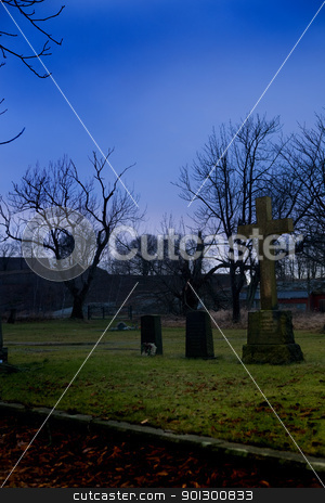 Graveyard stock photo, A spooky graveyard with a deep blue sky by Tyler Olson