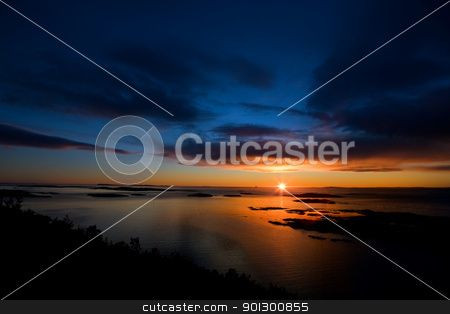 Dramatic Sunset on Ocean stock photo, Beautiful coastal Landsacpe on the very outside of the Oslo Fjord near Fredrikstad, Norway. by Tyler Olson