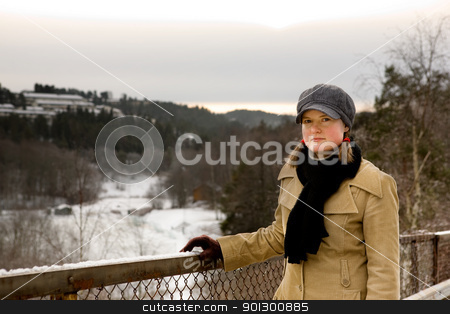 Young Woman with Freckles stock photo, A young woman outside in winter with freckles by Tyler Olson