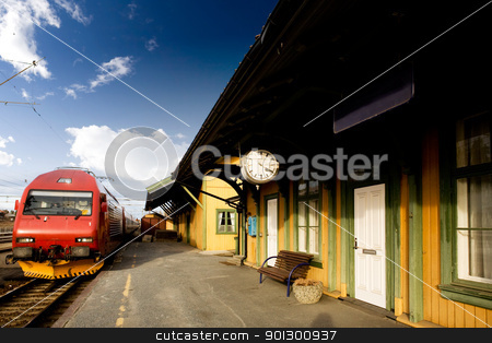 Old Train Station stock photo, An old train station against a deep blue sky by Tyler Olson