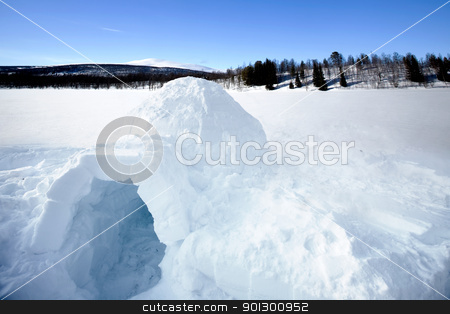 Igloo stock photo, An igloo on a frozen lake in the mountains by Tyler Olson