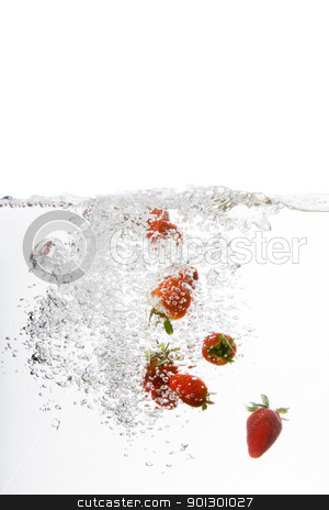 Strawberry Bubble stock photo, Fresh strawberries being poured in water by Tyler Olson