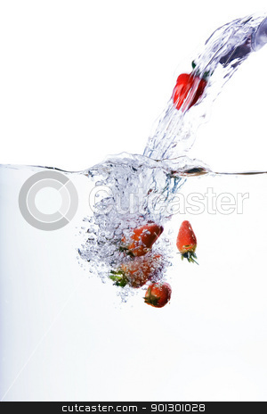 Fresh Strawberries stock photo, Fresh strawberries being poured in water by Tyler Olson