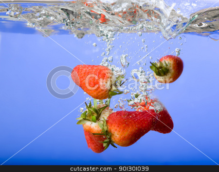 Strawberry Background in Water stock photo, Strawberries falling in blue water with splash and bubbles by Tyler Olson
