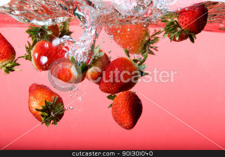 Strawberry Background in Water stock photo, Strawberries falling in red water with splash and bubbles by Tyler Olson