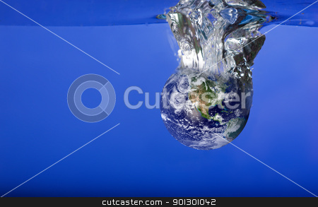 World Sinking in Water stock photo, A globe sinking in water with bubbles by Tyler Olson