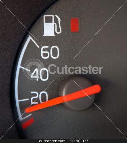 Gas Gauge stock photo, Gas Gauge showing nearly empty with red warning light by Tyler Olson