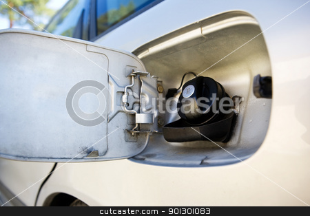 Car Fuel Tank stock photo, A fuel tank on a car open and ready for filling by Tyler Olson