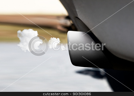 Clean Exhaust stock photo, A car tail pipe with exhaust coming out, clean concept by Tyler Olson