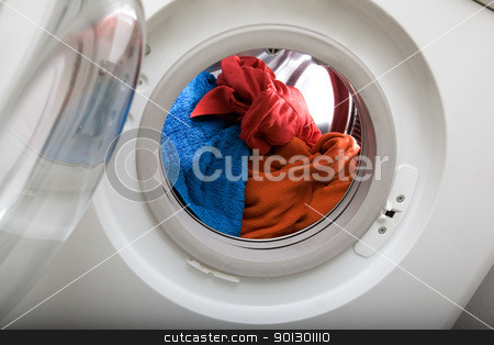 Load of Laundry stock photo, A colorful clothes wash by Tyler Olson