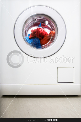 Washing Machine stock photo, Washing machine detail with colorful clothes by Tyler Olson
