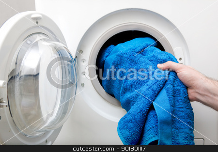 Washing Clothes stock photo, Washing clothes in a front loading washer by Tyler Olson