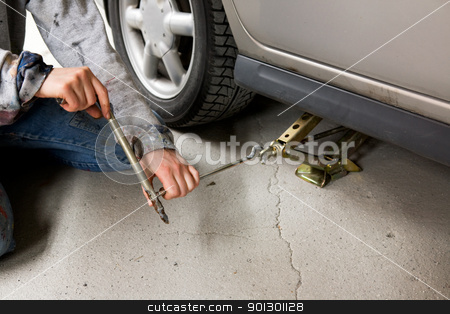 Jack and Car stock photo, Jacking up a car with the emergency jack by Tyler Olson